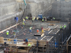 Construction crews worked to make sure yesterday's concrete pour went smoothly